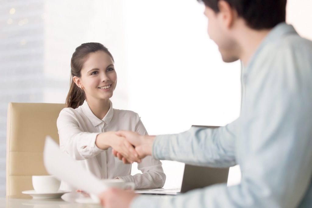 Hiring Manager Shaking the Hand of an Applicant